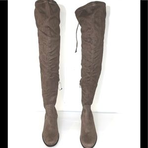Over the Knee Boot Mid Heel: about 1 1/2 inches